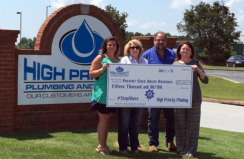 Left to Right: Katie Beam (Prevent Child Abuse Rockdale Community Outreach Coordinator), Diane Howington (Director of Prevent Child Abuse Rockdale), Brian Simpson & Paulette Simpson (Owners of High Priority Plumbing).